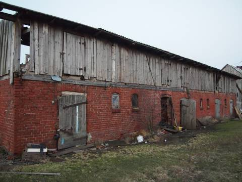 Hölzerne Häuser der Bauerknechten
